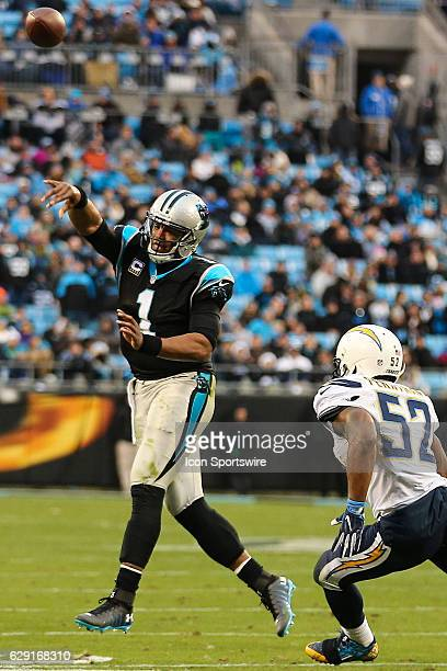 Carolina Panthers quarterback Cam Newton throws under pressure from San Diego Chargers inside linebacker Jatavis Brown during the second half between...