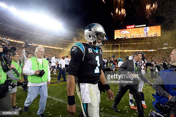Carolina Panthers quarterback Cam Newton walks off the field following a 2410 loss to the Denver Broncos in Super Bowl 50 at Levi's Stadium in Santa...