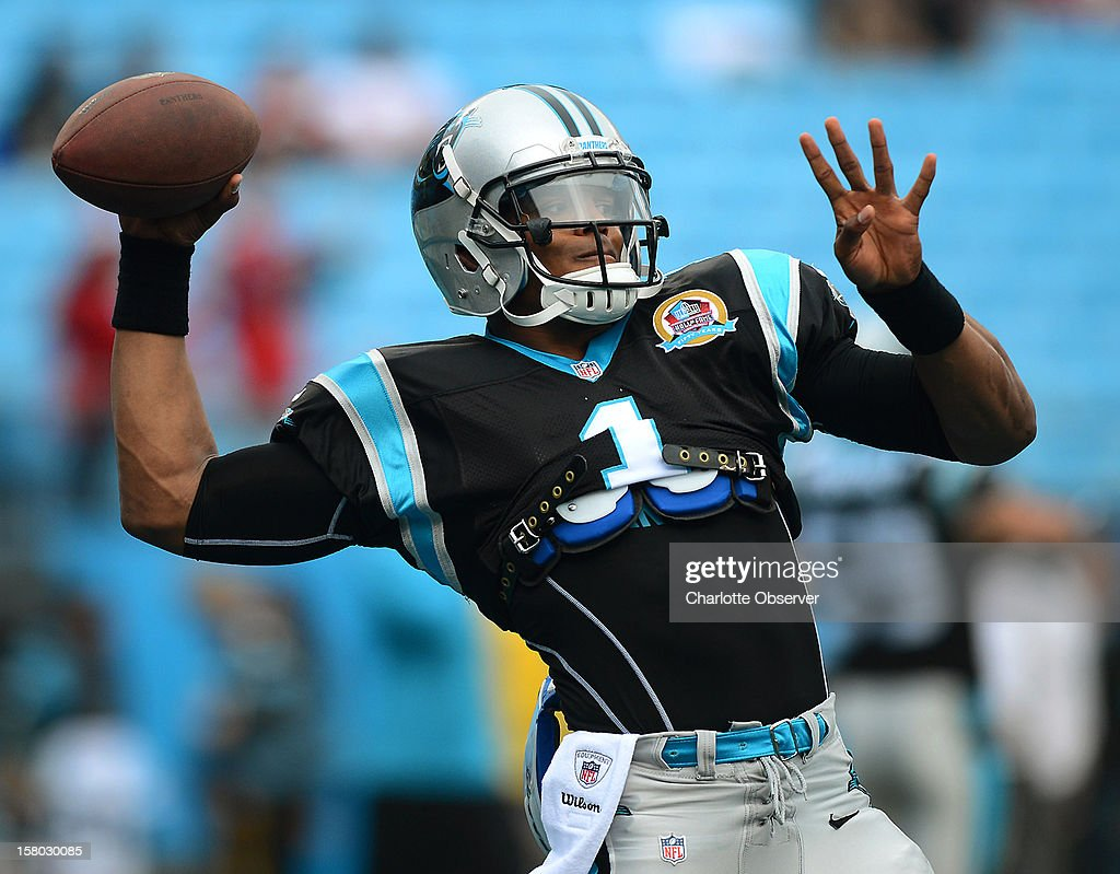 Carolina Panthers quarterback Cam Newton warms prior to NFL action against the Atlanta Falcons at Bank of America Stadium on Sunday, December 9, 2012, in Charlotte, North Carolina.