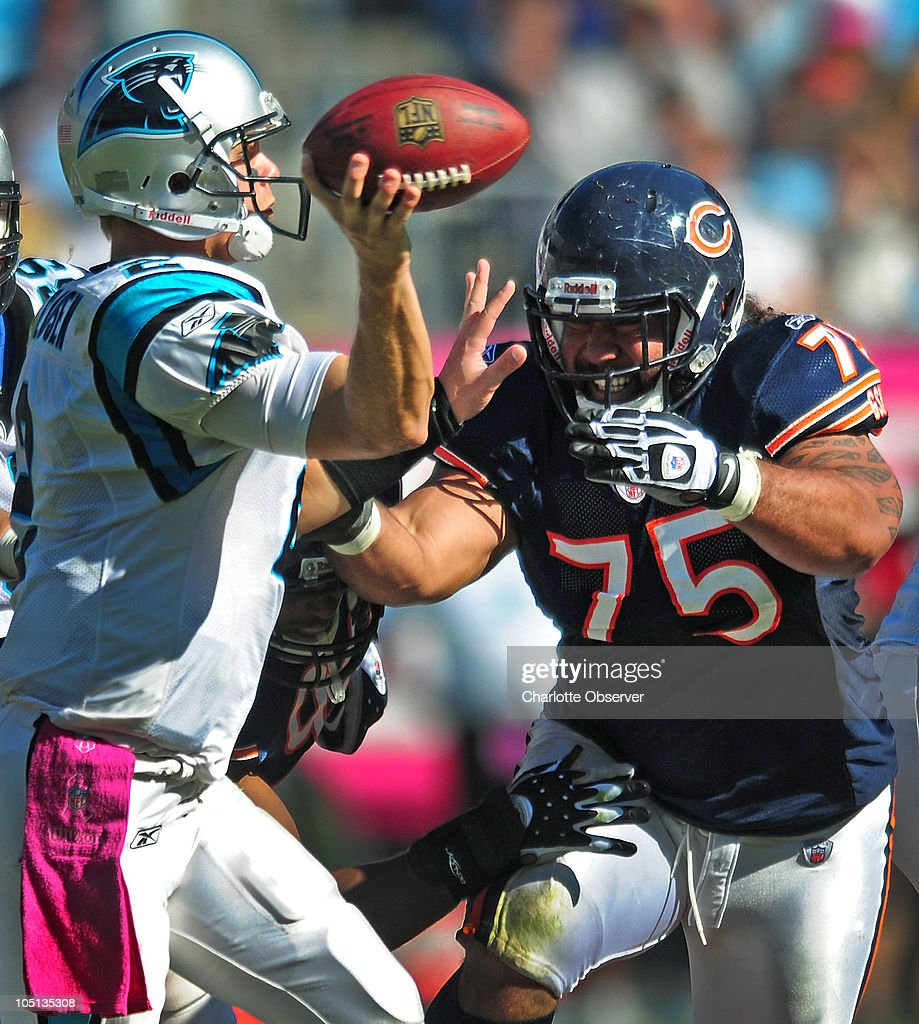 Carolina Panthers quarterback Jimmy Clausen (2) hurries a pass as Chicago Bears defensive tackle Matt Toeaina (75) applies pressure during third-quarter action at Bank of America Stadium in Charlotte, North Carolina, Sunday, October 10, 2010.