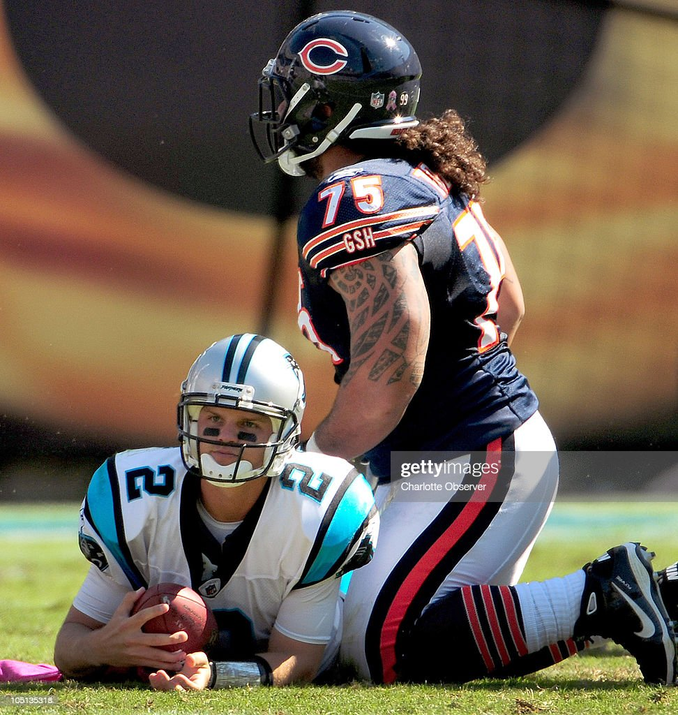 Carolina Panthers quarterback Jimmy Clausen (2) was sacked by Chicago Bears defensive tackle Matt Toeaina (75) during first-quarter action at Bank of America Stadium in Charlotte, North Carolina, Sunday, October 10, 2010.