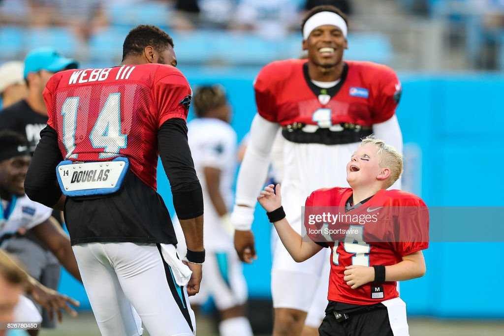 Carolina Panthers quarterback Joe Webb (14), quarterback Cam Newton (1) during warm ups with Make a Wish player Dom Fuller during Panthers FanFest Training Camp on August 04, 2017 at Bank of America Stadium in Charlotte, NC.