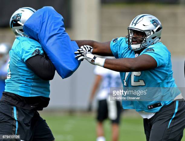 Carolina Panthers rookie tackle Taylor Moton right runs a drill during the second session of the team's rookie minicamp in Charlotte NC on Friday May...