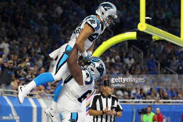 Carolina Panthers running back Christian McCaffrey celebrates with offensive tackle Daryl Williams after scoring a touchdown during the first half of...