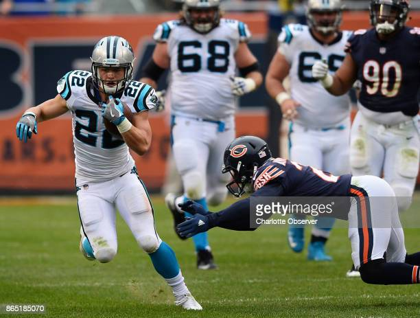 Carolina Panthers running back Christian McCaffrey left rushes as the Chicago Bears defense attempts to make a tackle during third quarter action on...