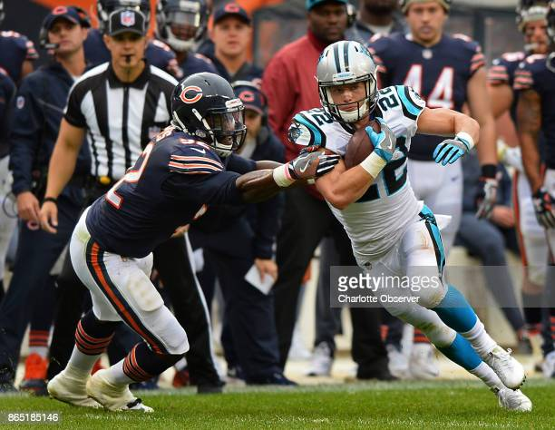 Carolina Panthers running back Christian McCaffrey right looks back to the middle of the field as Chicago Bears linebacker Christian Jones attempts...