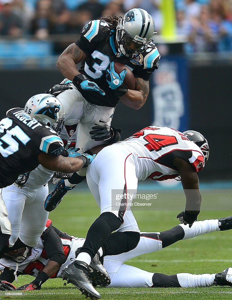 Carolina Panthers running back DeAngelo Williams rushes for yardage against the Atlanta Falcons during first-quarter action at Bank of America Stadium on Sunday, December 9, 2012, in Charlotte, North Carolina.