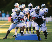 Carolina Panthers running back Jonathan Stewart left and full back Mike Tolbert cut around pads during practice on Sunday August 2 at Wofford College...