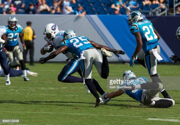 Carolina Panthers safety Damian Parms dives to tackle Tennessee Titans tight end Jace Amaro during the preseason NFL game between the Tennessee...
