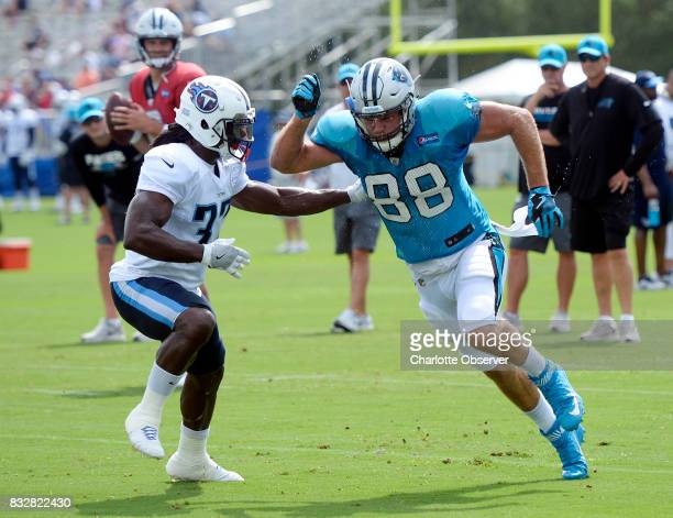 Carolina Panthers tight end Greg Olsen sprints out for a pass against Tennessee Titans strong safety Johnathan Cyprien during a joint practice on...