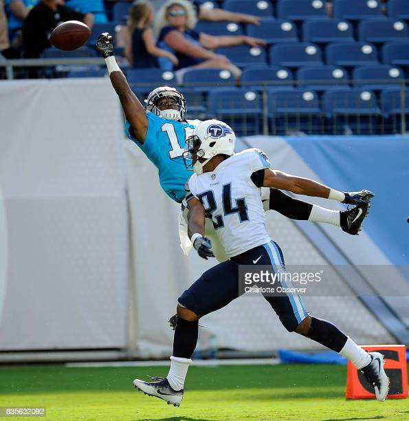 Carolina Panthers wide receiver Austin Duke reaches up for a pass in the end zone as Tennessee Titans defensive back Kalan Reed applies pressure...