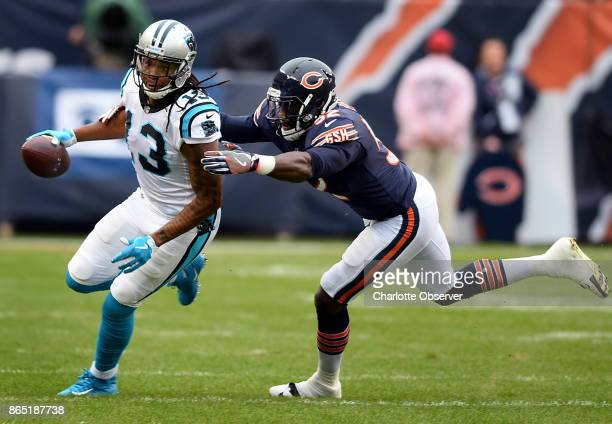 Carolina Panthers wide receiver Kelvin Benjamin breaks to the outside following a pass reception as Chicago Bears linebacker Christian Jones right...