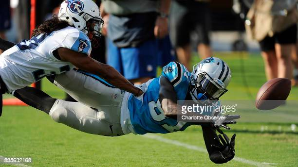 Carolina Panthers wide receiver Mose Frazier tries to come up with a catch as Tennessee Titans defensive back Manny Abad defends during the second...