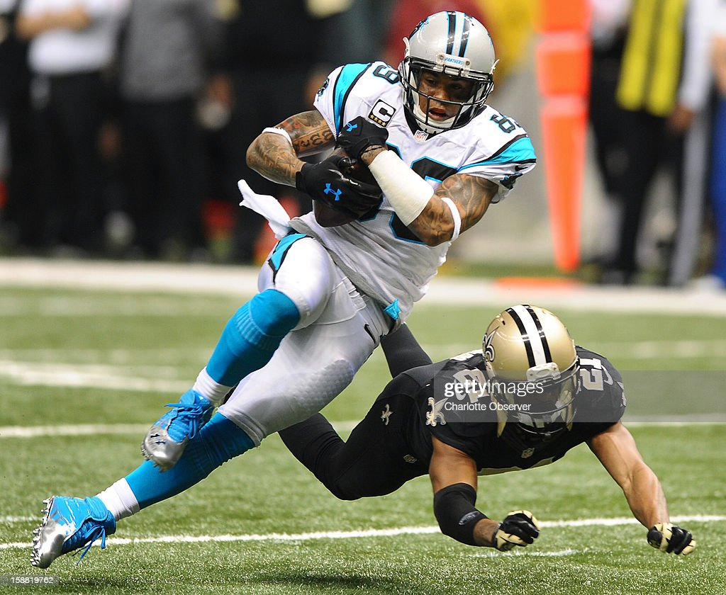 Carolina Panthers wide receiver Steve Smith (89) secures the ball after making a pass reception, as New Orleans Saints cornerback Patrick Robinson (21) looks to make the tackle, during third-quarter action at the Mercedes-Benz Superdome in New Orleans, Louisiana, Sunday, December 30, 2012. The Panthers defeated the Saints, 44-38.