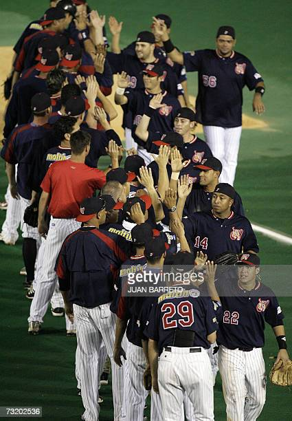 Venezuelan Tigres de Aragua players celebrate after winning against Mexican Naranjeros de Hermosillo during their Caribbean Series game at the...