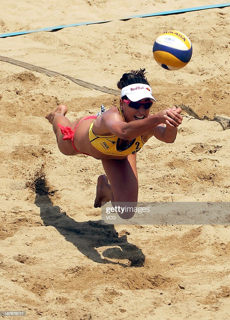 Carolina Solberg Salgado of Brazil in action against Barbara Hansel and Katharina Schutzenhofer of Austria during the women's qualification of FIVB Beach Volleyball Shanghai Grand Slam at Jinshan City Beach on May 1, 2013 in Shanghai, China.