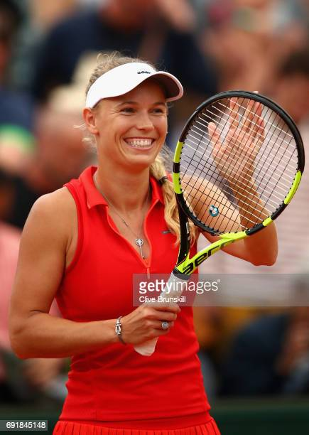 Carolina Wozniacki of Denmark celebrates victory following the ladies singles third round match against Catherine Bellis of The United States on day...