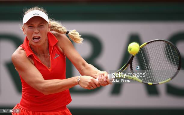 Carolina Wozniacki of Denmark plays a backhand during the ladies singles fourth round match against Svetlana Kuznetsova of Russia on day eight of the...
