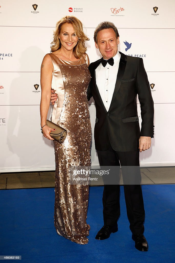 <a gi-track='captionPersonalityLinkClicked' href=/galleries/search?phrase=Caroline+Beil&family=editorial&specificpeople=226721 ng-click='$event.stopPropagation()'>Caroline Beil</a> and Bernard Hiller arrive for the Cinema For Peace 2014 - Gala at Konzerthaus Am Gendarmenmarkt on February 10, 2014 in Berlin, Germany.