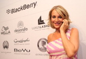 Caroline Beil poses with a Blackberry Z10 smartphone at the Blackberry Style Lounge during MercedesBenz Fashion Week in Berlin on July 3 2013 in...