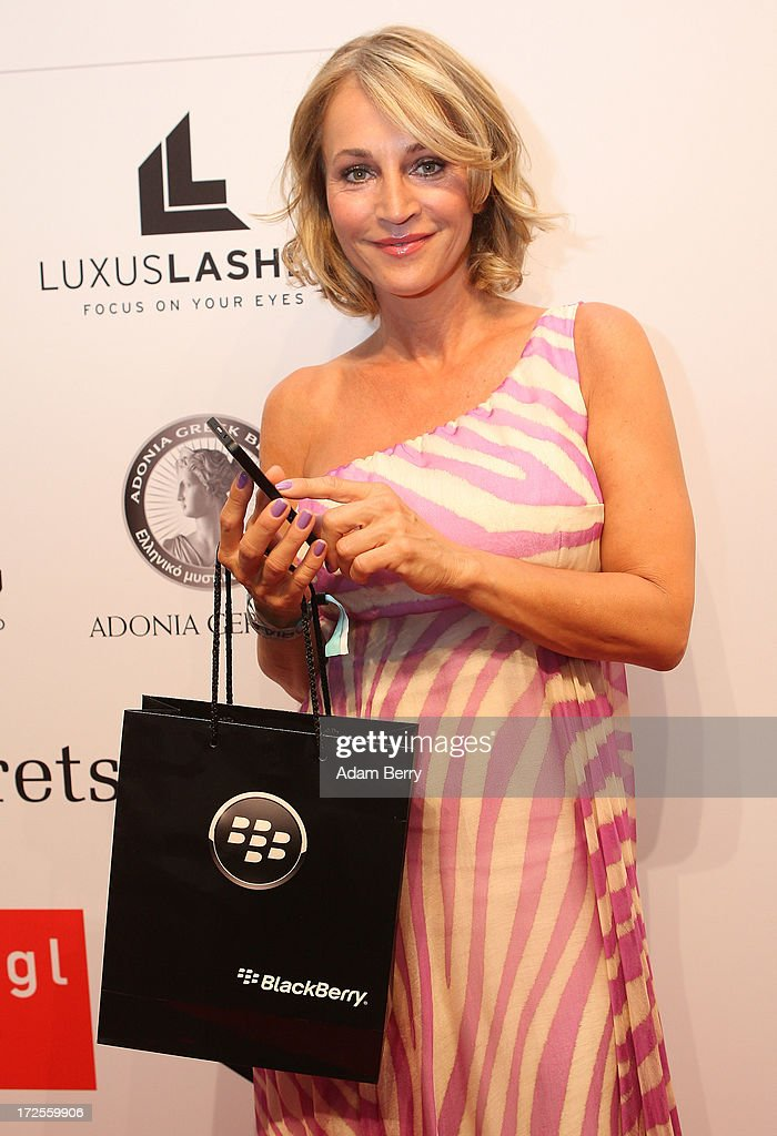 Caroline Beil poses with a Blackberry Z10 smartphone at the Blackberry Style Lounge during Mercedes-Benz Fashion Week in Berlin on July 3, 2013 in Berlin, Germany.