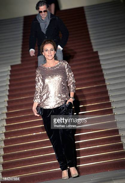 Caroline Beil presents 'Minx' fashon during the celebrity fashion at the Minx fashion night at Residenz on October 12 2013 in Wuerzburg Germany The...