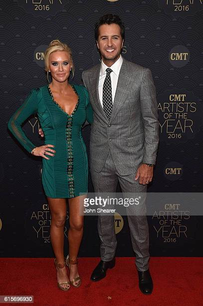 Caroline Boyer and singersongwriter Luke Bryan arrive on the red carpet at CMT Artists of the Year 2016 on October 19 2016 in Nashville Tennessee