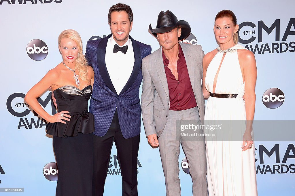 Caroline Boyer, <a gi-track='captionPersonalityLinkClicked' href=/galleries/search?phrase=Luke+Bryan&family=editorial&specificpeople=4001956 ng-click='$event.stopPropagation()'>Luke Bryan</a>, <a gi-track='captionPersonalityLinkClicked' href=/galleries/search?phrase=Tim+McGraw&family=editorial&specificpeople=202845 ng-click='$event.stopPropagation()'>Tim McGraw</a> and <a gi-track='captionPersonalityLinkClicked' href=/galleries/search?phrase=Faith+Hill&family=editorial&specificpeople=175933 ng-click='$event.stopPropagation()'>Faith Hill</a> attend the 47th annual CMA Awards at the Bridgestone Arena on November 6, 2013 in Nashville, Tennessee.