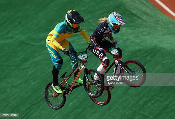 Caroline Buchanan of Australia and Brooke Crain of the United States compete during the Women's BMX Semi Finals on day 14 of the Rio 2016 Olympic...