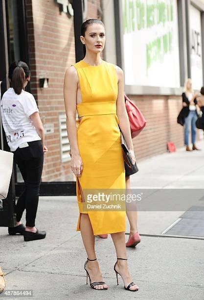 Caroline Byron is seen outside the Cushnie et Ochs show wearing a Cushnie et Ochs dress Marni bag and Gianvito Rossi shoes during New York Fashion...