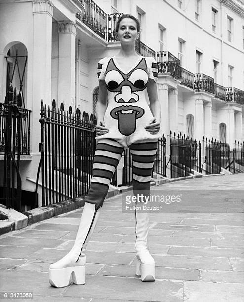 Caroline Coon models white platform boots and a redandwhite handknitted woollen jump suit by the Japanese designer Kansai Yamamoto London May 1971