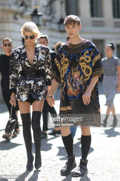 Caroline Daur and Tommy Dorfman attend the Balmain Menswear Spring/Summer 2018 show as part of Paris Fashion Week on June 24 2017 in Paris France