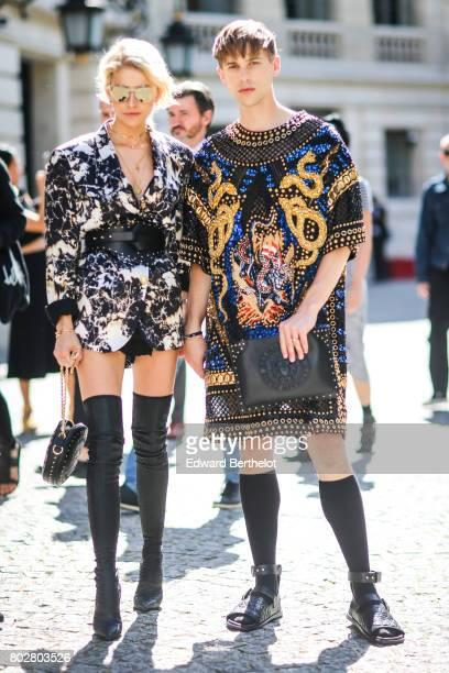 Caroline Daur and Tommy Dorfman attend the Balmain Menswear Spring/Summer 2018 show as part of Paris Fashion Week on June 24 2017 in Paris France