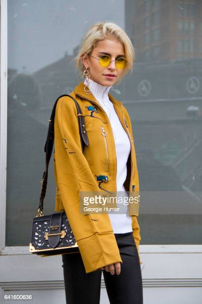Caroline Daur is seen at Spring Studios outside the Lacoste show wearing yellow embroidered jacket with flared sleeves yellow tint round sunglasses...