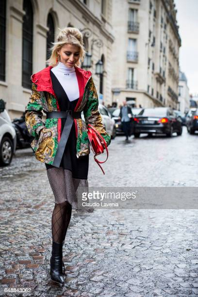 Caroline Daur poses wearing a Gucci windbreaker and Loewe bag in the streets of Paris before the Giambattista Valli show during Paris Fashion Week...