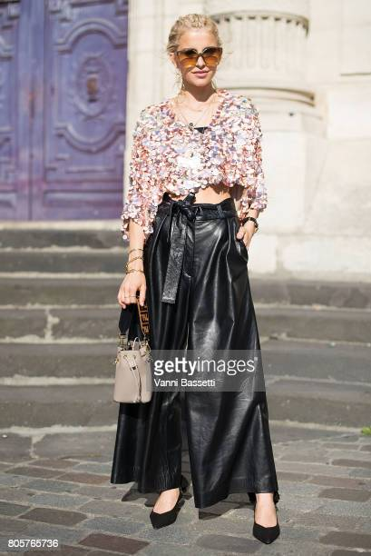 Caroline Daur poses with a Fendi bag after the Galia Lahav show at the Lycee Henri IV during Paris Fashion Week Haute Couture FW17/18 on July 2 2017...