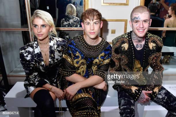 Caroline Daur Tommy Dorfman and Lil Peep attend the Balmain Menswear Spring/Summer 2018 show as part of Paris Fashion Week on June 24 2017 in Paris...