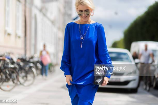 Caroline Daur wearing a blue top and pants and black clutch outside Baum Und Pferdgarten on August 10 2017 in Copenhagen Denmark