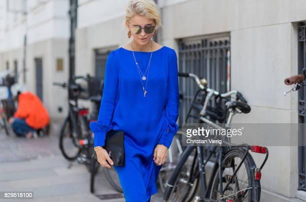 Caroline Daur wearing a blue top and pants and black clutch outside Baum Und Pferdgarten on August 10 2017 in Copenhagen Denmark