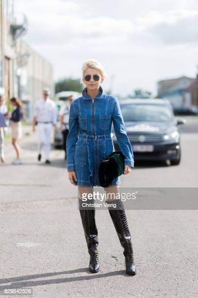 Caroline Daur wearing a denim dress overknees outside Ganni on August 10 2017 in Copenhagen Denmark