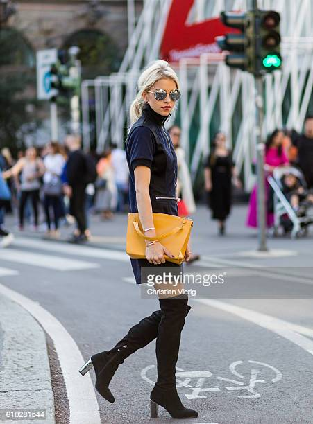 Caroline Daur wearing a navy Calvin Klein dress and Jil Sander bag outside Jil Sander during Milan Fashion Week Spring/Summer 2017 on September 24...