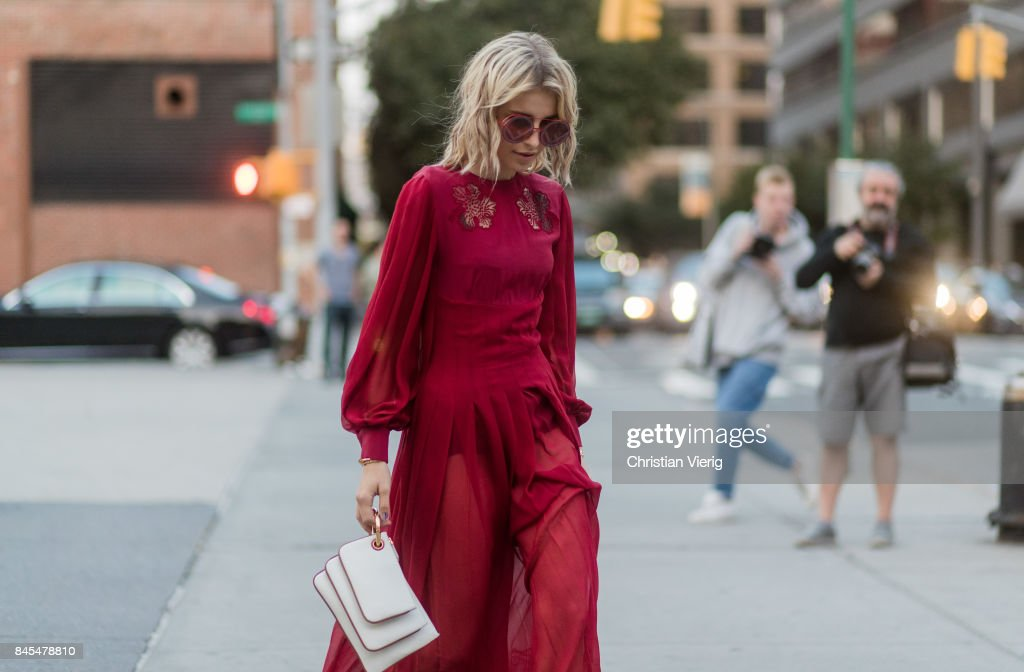 Caroline Daur wearing a red dress seen in the streets of Manhattan outside Prabal Gurung during New York Fashion Week on September 10, 2017 in New York City.
