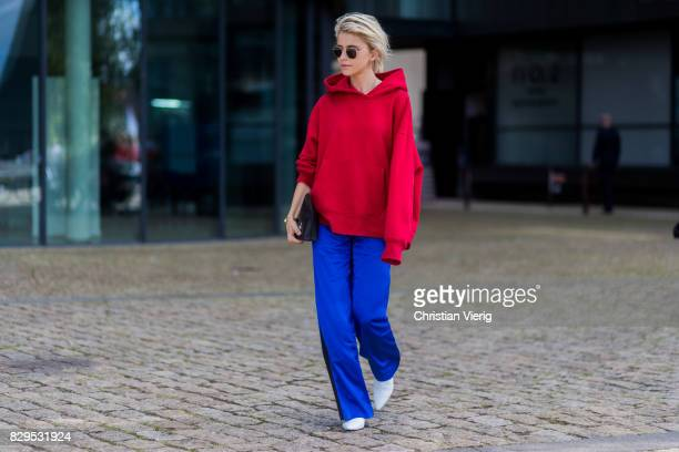Caroline Daur wearing a red hoody outside Designers Remix on August 10 2017 in Copenhagen Denmark