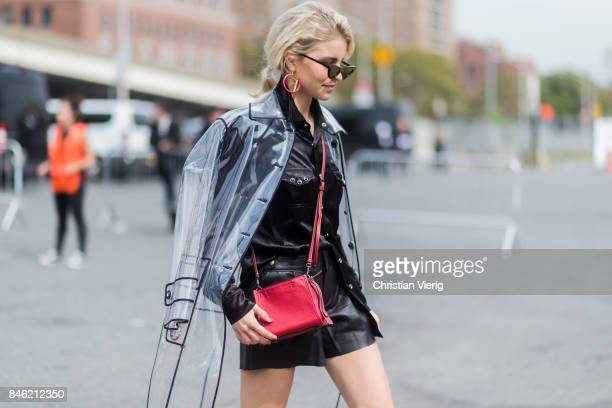 Caroline Daur wearing a sheer rain coat black shorts seen in the streets of Manhattan outside Coach during New York Fashion Week on September 12 2017...
