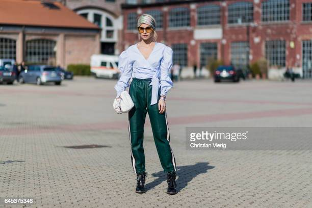Caroline Daur wearing blue top green jogger pants head band outside Missoni during Milan Fashion Week Fall/Winter 2017/18 on February 25 2017 in...