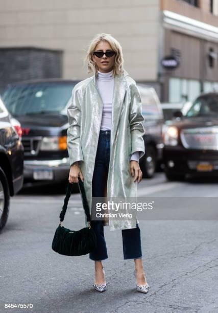 Caroline Daur wearing denim jeans mint coat seen in the streets of Manhattan outside Sies Marjan during New York Fashion Week on September 10 2017 in...
