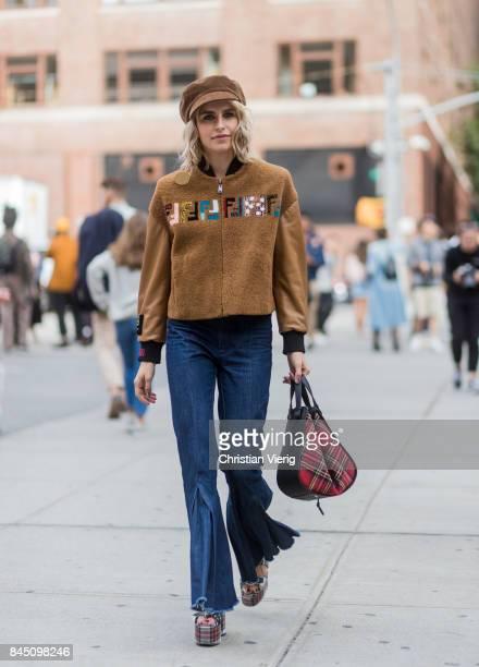 Caroline Daur wearing Fendi jacket flat cap Loewe bag seen in the streets of Manhattan outside Jonathan Simkhai during New York Fashion Week on...