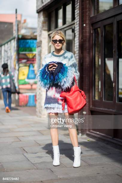 Caroline Daur wearing knit dress ankle boots red bag outside Marques Almeida during London Fashion Week September 2017 on September 18 2017 in London...