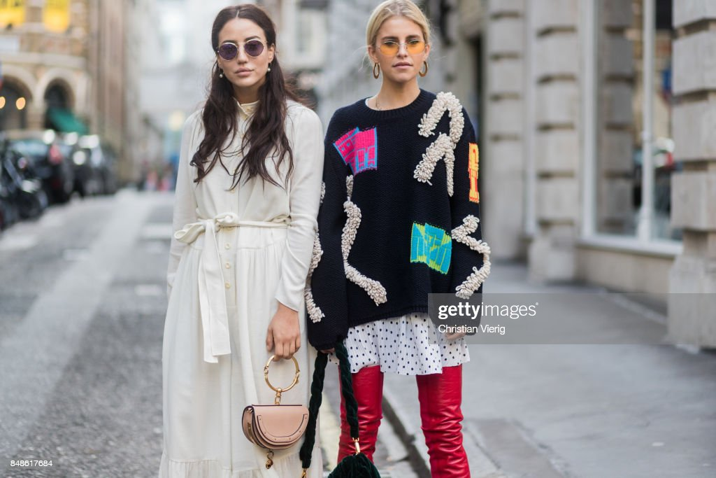 Caroline Daur wearing knit, red overknee boots and Tamara Kilic wearing white dress, Chloe bag outside Peter Pilotto during London Fashion Week September 2017 on September 17, 2017 in London, England.