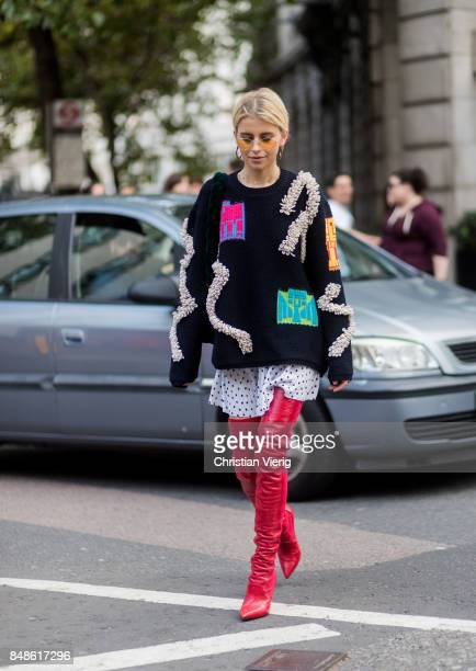 Caroline Daur wearing knit red overknee boots outside Peter Pilotto during London Fashion Week September 2017 on September 17 2017 in London England